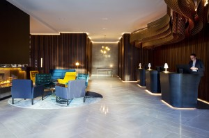 Crowne Plaza Christchurch lobby welcomes with plush seating and central fireplace. Photo credit-Designworks